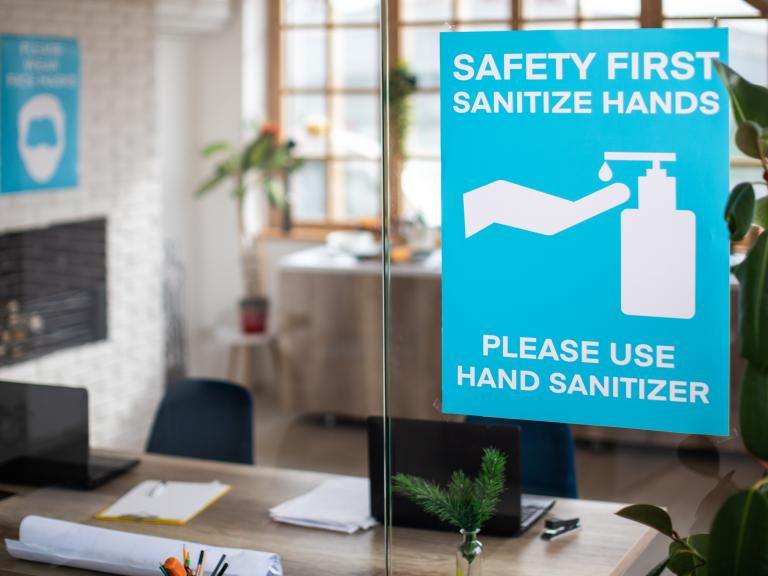 Hand sanitizer signs for office reopening.